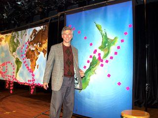CWC2 Rex Ziak in front of maps